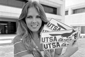 Liz Pearce shows off bumper stickers