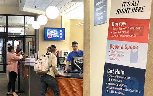 The John Peace Library is merging the circulation desk with the information desk to form a single-service area.